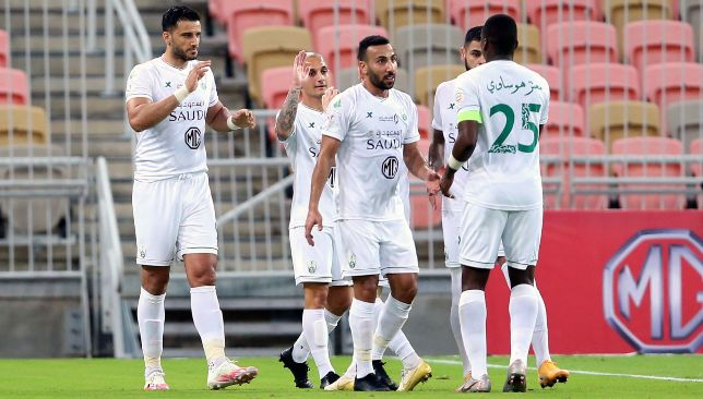 Omar Al Somah (l) should be back for Al Ahli Jeddah (EPA).