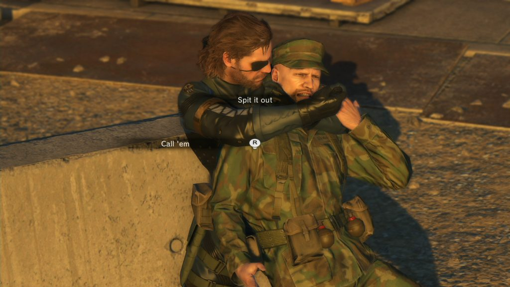 Snake in Metal Gear Solid V: Ground Zeroes interrogating a guard for information