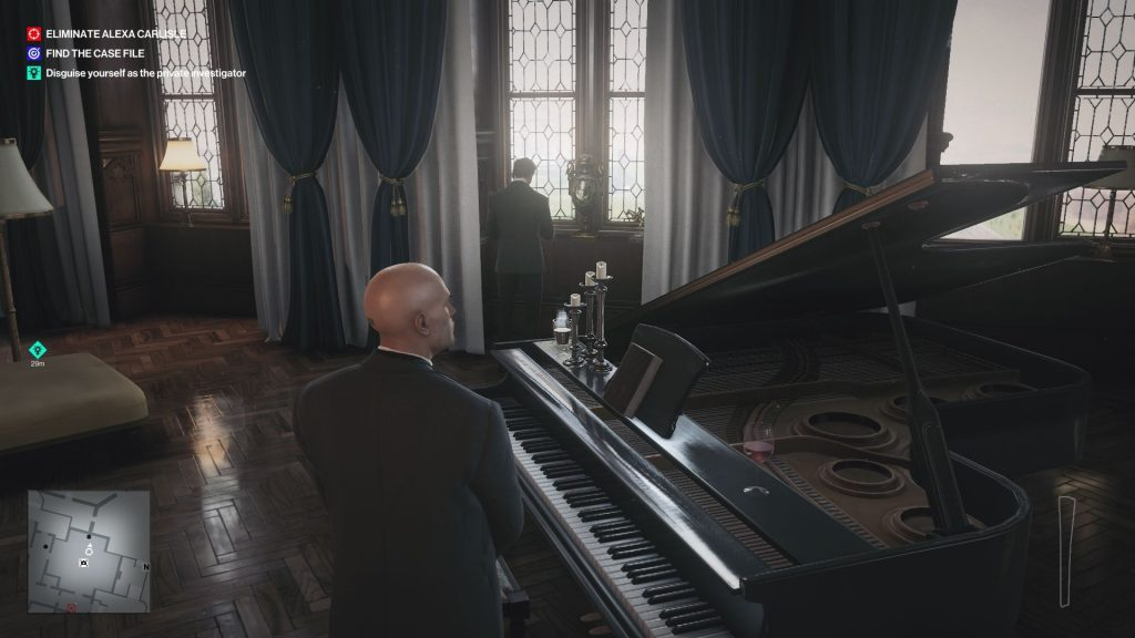 Agent 47 stands next to a piano in the dining hall of a stately home. He is dressed in a smart suit and is watching a man, who is looking out of a window. You imagine he would be easily killed.