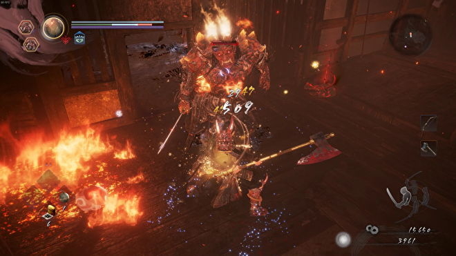 I swing my axe at a fiery, humanoid yokai. Fire spreads through the room we're in.