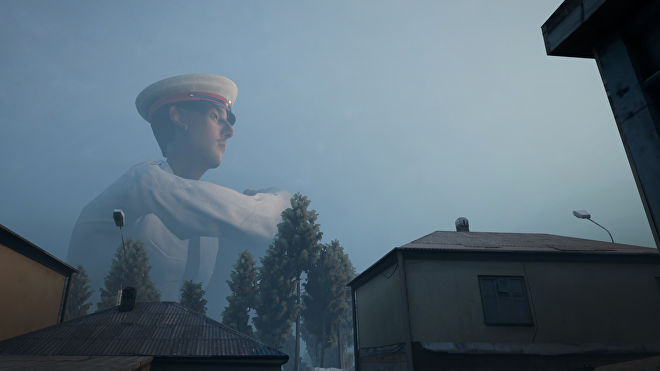 A giant policeman sits behind a town in a Militsioner screenshot.