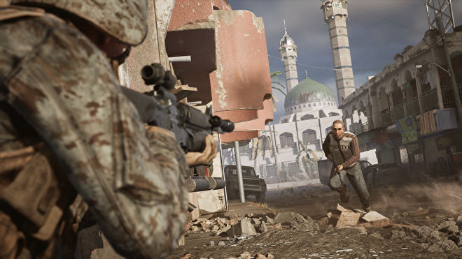 A soldier aims at an armed man in civilian clothing in a Six Days In Fallujah screenshot.