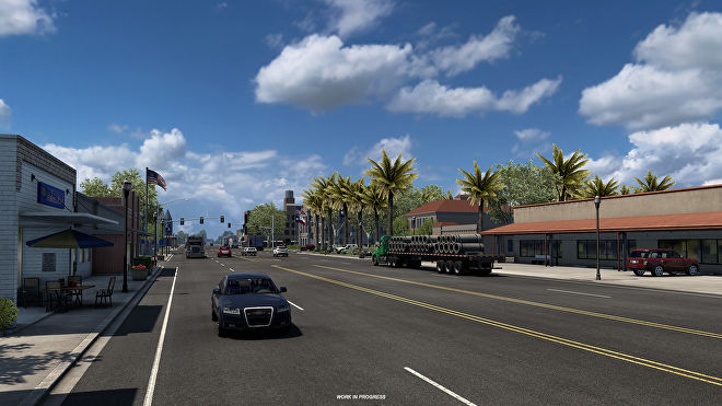 American Truck Simulator Texas - A five lane road with cars and trucks passes through a commercial area with palm trees.