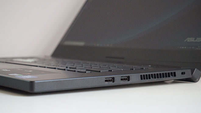 A photo of the Asus TUF Dash 15 gaming laptop's USB ports on a white desk