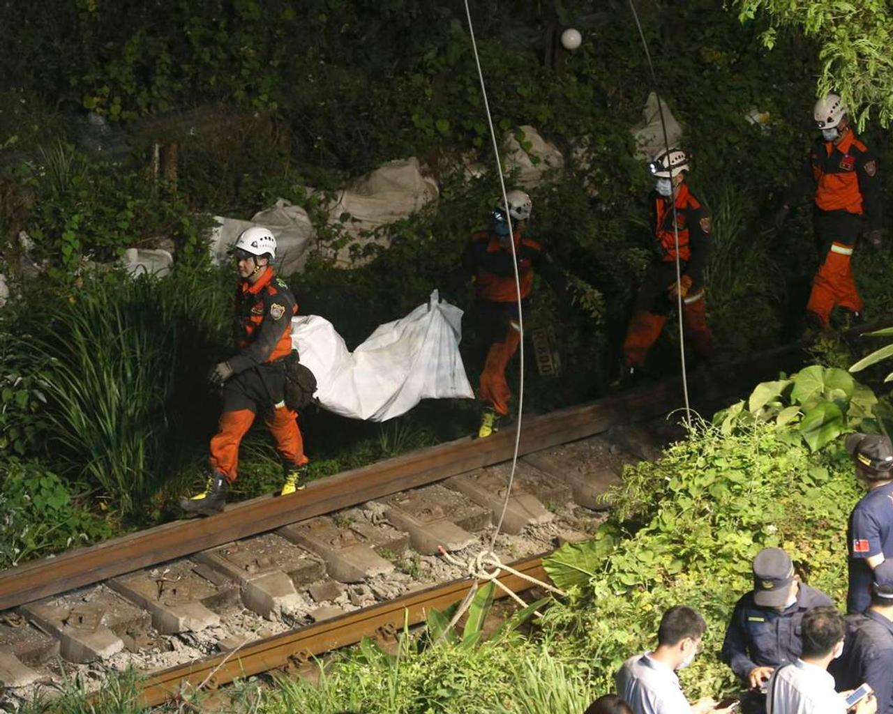 In Taiwan, a train collides with a truck that has slid into the track, killing 51 people.