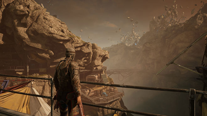 A player character looking out over a rocky valley in Outriders, running at 4K Ultra settings with DLSS Balanced enabled