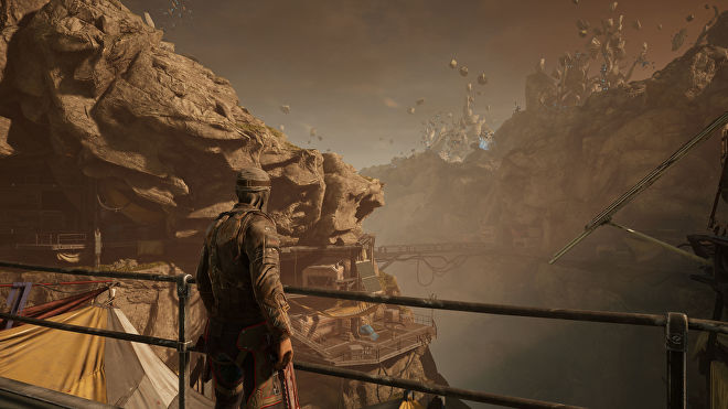 A player character looking out over a rocky valley in Outriders, running at 4K Ultra settings with DLSS Quality enabled