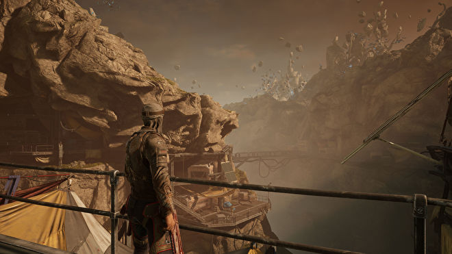 A player character looking out over a rocky valley in Outriders, running at 4K Ultra settings with DLSS Performance enabled
