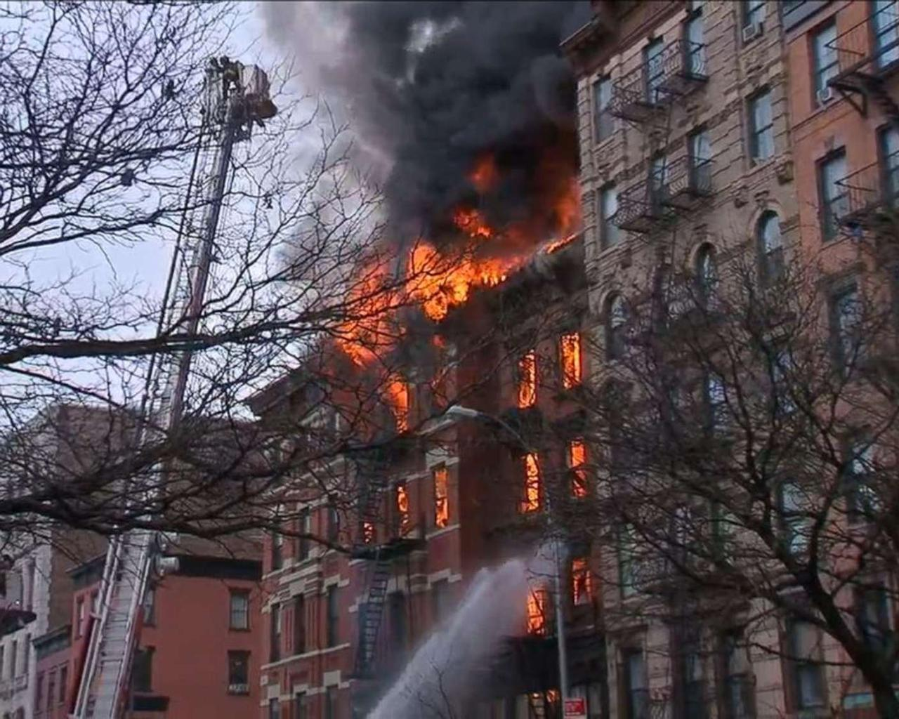 An eight-alarm fire in a New York City building clears hundreds