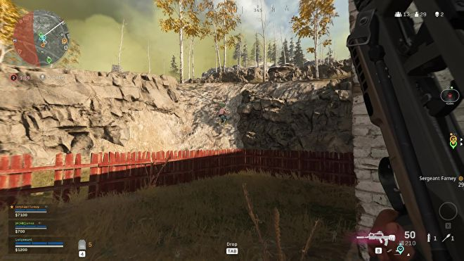 My teammate attempts to climb a rocky slope in Warzone, to no avail.