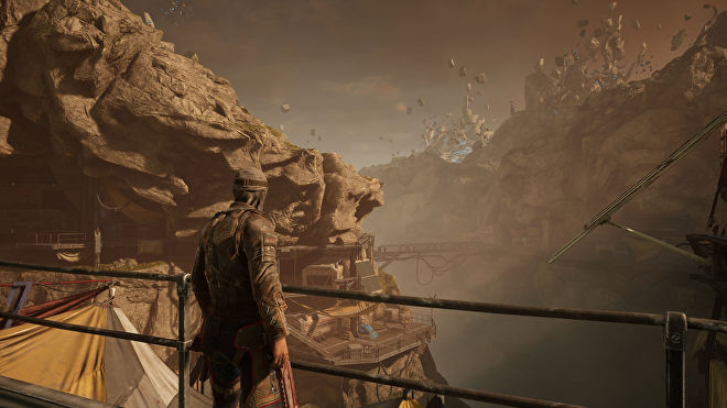A player character looking out over a rocky valley in Outriders, running at 4K Ultra settings (native)